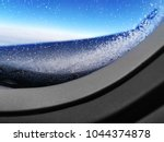close up of aircraft porthole... | Shutterstock . vector #1044374878