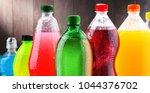 plastic bottles of assorted... | Shutterstock . vector #1044376702