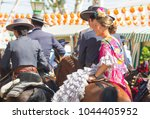 Small photo of SEVILLE, SPAIN - APR: people in traditional costumes riding horse at feria de abril on April, 2014 in Seville, Spain