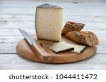 manchego cured cheese  knife... | Shutterstock . vector #1044411472