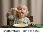 cute baby eating spaghetti... | Shutterstock . vector #1044415558
