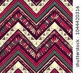 seamless ethnic zigzag chevron... | Shutterstock .eps vector #1044420316