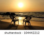 Two Empty Chairs On The Beach...