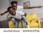 cheerful young african american ... | Shutterstock . vector #1044422956