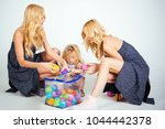 child small boy and twins women ... | Shutterstock . vector #1044442378