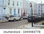 Small photo of London, UK - March 11, 2018: Facades of typical colorful terraced houses in Notting Hill, area of London famous for its carnival.