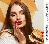 portrait of playful beautiful...   Shutterstock . vector #1044493396