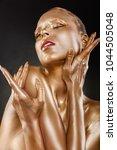 gilded body. golden makeup.... | Shutterstock . vector #1044505048