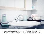 stack of towels  in the... | Shutterstock . vector #1044518272
