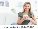 a woman sitting on the couch... | Shutterstock . vector #104455406