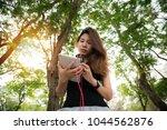 asian teen girl listening to...   Shutterstock . vector #1044562876