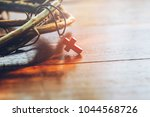 Small photo of close up of the red cross hang on crown of thorns of Jesus on wooden background with copy space, can be used for Christian concept , Easter concept, Vintage tone