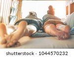 happy couple lying on bed... | Shutterstock . vector #1044570232