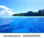 An Island With Layered Of Blue...