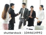 business people shaking hands ... | Shutterstock . vector #1044614992