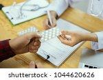 doctors and patient are...   Shutterstock . vector #1044620626