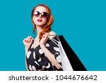 redhead woman in sunglasses...   Shutterstock . vector #1044676642