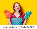 redhead housewife with gloves...   Shutterstock . vector #1044676786