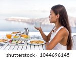luxury resort woman drinking... | Shutterstock . vector #1044696145