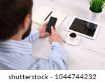 hand hold phone on stylish...   Shutterstock . vector #1044744232