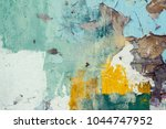 old colorful paint on conrete... | Shutterstock . vector #1044747952