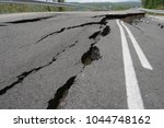road collapses with huge cracks.... | Shutterstock . vector #1044748162