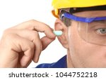 male worker with ear plug ... | Shutterstock . vector #1044752218