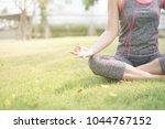 yoga practice outdoor concept.... | Shutterstock . vector #1044767152