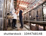 two male technicians working at ... | Shutterstock . vector #1044768148