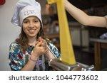 girl cooking pasta | Shutterstock . vector #1044773602