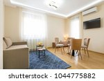 interior of a hotel apartment ... | Shutterstock . vector #1044775882