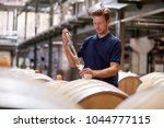 young man testing wine in a... | Shutterstock . vector #1044777115