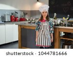 young chef in the kitchen | Shutterstock . vector #1044781666