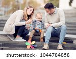 parents and boy look happy and... | Shutterstock . vector #1044784858