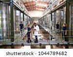 two staff talking on gangway in ... | Shutterstock . vector #1044789682