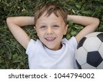 portrait of a young  boy with... | Shutterstock . vector #1044794002