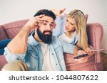 bearded young man trying to... | Shutterstock . vector #1044807622