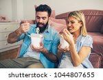 modern lazy young couple eating ... | Shutterstock . vector #1044807655