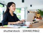 young businesswoman working... | Shutterstock . vector #1044819862