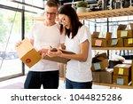 happy people working with... | Shutterstock . vector #1044825286