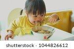 asian little girl eating... | Shutterstock . vector #1044826612
