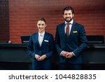 hotel receptionists standing... | Shutterstock . vector #1044828835