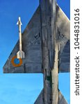 Small photo of February 2018: Monument of rocketing Su-24 plane in winter park near air force academy, detail with missile, Kharkiv, Ukraine