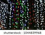 defocused bokeh lights on dark... | Shutterstock . vector #1044839968