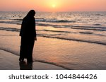 woman in hijab standing on the...   Shutterstock . vector #1044844426