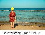 a little child on the beach... | Shutterstock . vector #1044844702