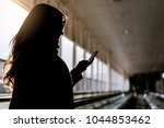 unrecognizable woman using the... | Shutterstock . vector #1044853462