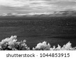 windy and cloudy day at... | Shutterstock . vector #1044853915