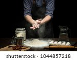 Small photo of Hand strewing flour to make a dough on wooden table