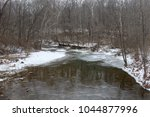 The Icy Frozen Creek In The...